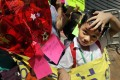 Children born to Mainland-Hong Kong families protest outside Central Government's liaison office in Hong Kong on Sept. 19, 2013, demanding mainland Chinese Government to grant their mothers one way permit for family reunion. Photo: SCMP/Edward Wong