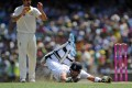 England batsman Kevin Pietersen dives to make his ground on the second day of the fifth Ashes test. Photo: AFP