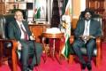 Sudan President Omar al-Bashir (left) and his South Sudan counterpart Salva Kiir pose before a meeting on Monday in Juba. Photo: AFP