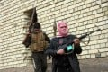 Gunmen patrol during clashes with Iraqi security forces in Fallujah, Iraq. Photo: AP