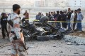 Pakistani security officials at the site of a bomb blast that killed senior police official Chaudhry Aslam on Thursday. Photo: EPA