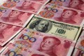 The yuan reference rate, the onshore daily fixing rate set by the People's Bank of China, set record highs 41 times last year. Photo: Reuters