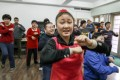 Children with developmental problems enjoy a dance routine at Yu Huigeng's music therapy session in Beijing. Photos: Simon Song