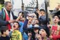 Children chant slogans after Sharon's death. Photo: AP