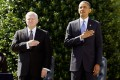 Robert Gates (left) says he respects Barack Obama (right), but is less impressed with his National Security Council staff. Photo: AFP