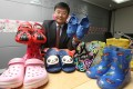 Prof. Ron Hui, from the Consumer Council, displays some of the plastic shoe samples. Photo: Edward Wong