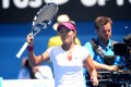 China's Li Na acknowledges the crowd after defeating Switzerland's Belinda Bencic on Wednesday. Photo: Xinhua
