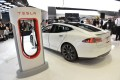 A Tesla electric car and a charging station, displayed at an American automotive show. Photo: AFP