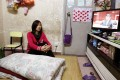 Du Runxing,  who lives in the subdivided flat in Sham Shui Po with her family, hopes CY Leung can tell when they can move to a public housing flat. Photo: Dickson Lee