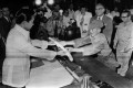 Hiroo Onoda offers his sword to former president Ferdinand Marcos at the Malacanan Palace on March 11, 1974. Photo: AFP