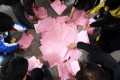 Ballots lie on the floor after the village committee election in March 2012 in Wukan. Photo: Felix Wong
