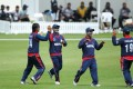 Nepal's teammates celebrate taking a wicket in an earlier match in New Zealand. Hong Kong will have to be wary of their rivals in one of two final games. Photo: 2014 © IDI/Getty Images