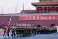 Chinese national flag guards escort the flag across the Chang'an Avenue in Beijing on January 1, 2014. Photo: Xinhua