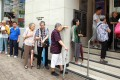 Citizens wait outside a bank for the subscription of the third issue of iBonds - which are issued by the government. The government could issue its first Islamic bond later this year. Photo: Dickson Lee