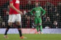Manchester United goalkeeper David de Gea closes his eyes after making an error which gifted Sunderland a goal. Photo: AP