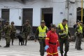 Colombian security forces inspect the site of a car bomb explosion in the Valle del Cauca region on January 16. Photo: AFP