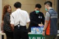 Customs officials inspect excess amount of milk powder carry by a traveller in Lo Wu.