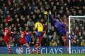 Arsenal goalkeeper Wojciech Szczesny makes an acrobatic save against Southampton. Photo: AP