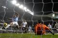 Manchester City captain Vincent Kompany puts the final nail in Tottenham Hotspur's coffin. Photo: AP