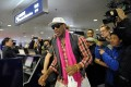 Rodman on his way to Pyongyang in January. He is now offering to take Kenneth Bae's place in a North Korean jail. Photo: AFP
