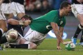 Ireland's Rob Kearney celebrates after scoring a try, despite being tackled by Scotland's Ryan Wilson during their Six Nations match at the Aviva Stadium in Dublin. Photo: AP