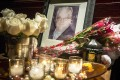 A makeshift memorial outside the New York apartment building where the body of Philip Seymour Hoffman was found. Photo: EPA