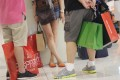 Shoppers at Canton Road in Tsim Sha Tsui. Total retail sales in Hong Kong grew a modest 11 per cent last year from 2012. Photo: David Wong