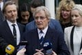 British actor William Roache (centre), talks to the press in Preston, England on Thursday after being found not guilty on sexual offences charges. Photo: AP
