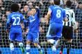 Eden Hazard celebrates his hat-trick against Newcastle. Photo: AFP