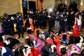 Police with suspects who were detained during a raid as part of plans to crackdown on prostitution, at a hotel in Dongguan. Photo: Reuters