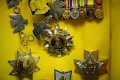 A self-styled royal wore these medals, cheapening the Malay royal title datuk, which has long been a high honour.Photo: AFP