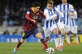 Goalscorers Lionel Messi and Antoine Griezmann in action. Photo: AFP