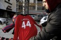 A street vendor shows a Manchester United jersey bearing the number of forward Adnan Januzaj in Pristina, Kosovo. Photo: AFP