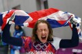 Britain's Lizzy Yarnold celebrates  after winning the women's skeleton event at the Winter Olympics. Photo: Reuters
