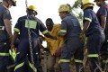 Rescuers tend to one of the 11 workers who was rescued from the illegal mine at Benoni, just outside Johannesburg. Photo: AFP