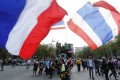 Thai anti-government protesters wave national flags during a rally near Government House in Bangkok. Photo: EPA