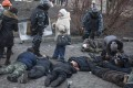 Police guard wounded protesters after the clashes. Photo: Reuters