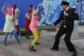 A Cossack militiaman attacks Nadezhda Tolokonnikova as Pussy Riot, including Maria Alyokhina (left), perform in Sochi.Photo: AP