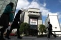 JPX, created last year from the merger of the Tokyo Stock Exchange and Osaka Securities Exchange, would weigh combining its Mothers, TSE Second Section and Jasdaq markets. Photo: Bloomberg