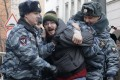 A protester is arrested outside the courthouse. Photo: Reuters