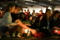 People attend a candlelight vigil in support of asylum seekers in Sydney. Photo: AFP
