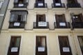 """""""For Sale"""" signs hang from balconies in Madrid. Photo: Reuters"""