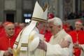 Pope Francis greets Pope Emeritus Benedict XVI in Saint Peter's Basilica at the Vatican in Rome