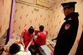 A policeman (right) inspects a public bathhouse in Qingdao in Shandong province.Photo: AFP