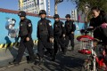 Armed policemen patrol on a street near the Kunming Railway Station on March 3, 2014. Photo: AP
