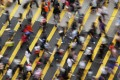 Are cities warping our minds? It may feel that way in Mong Kok (pictured), and scientists have evidence to support the theory. Photo: Reuters