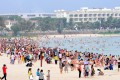 Tourists enjoy the beach at Sanya in Hainan province. The area reported just one slightly polluted day in the fourth quarter, against 189 days of pollution in Beijing. Photo: Xinhua