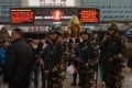 Chinese paramilitary police patrol outside the scene of the attack at the main train station in Kunming, Yunnan Province, on March 3, 2014. Photo: AFP