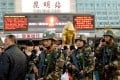 Chinese paramilitary police patrol outside the scene of the attack at the main train station in Kunming on Monday. Photo: AFP