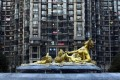 A sculpture in front of a Beijing tower block - Premier Li Keqiang signalled a different approach from his predecessor's battle to control the property market. Photo: Reuters